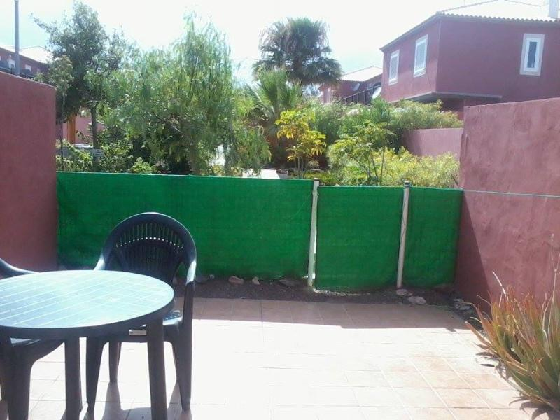 Private back garden with views of communal gardens
