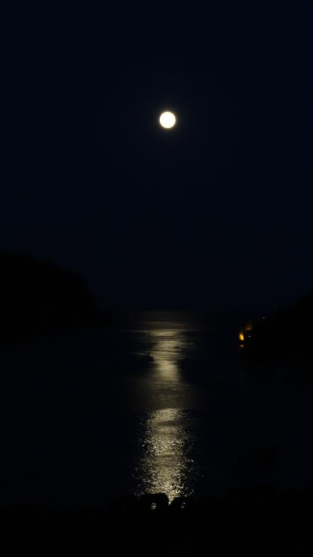 The moon over the estuary and dim lights fro Dartmouth castle from the sitting room