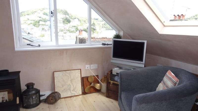 Flat screen TV and nautical items
