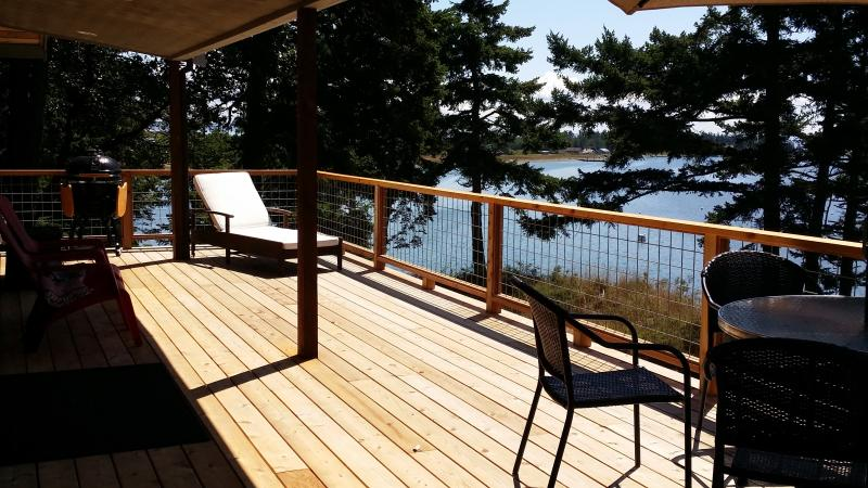 Commanding views from high bank waterfront.