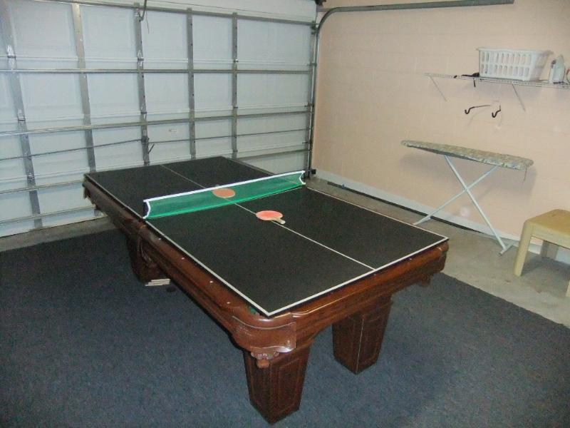 Games room with pool table and ping pong table.