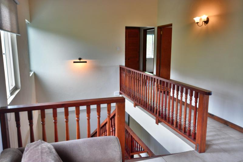 Upstairs landing leading to all bedrooms & then stairs going downstairs to the living area