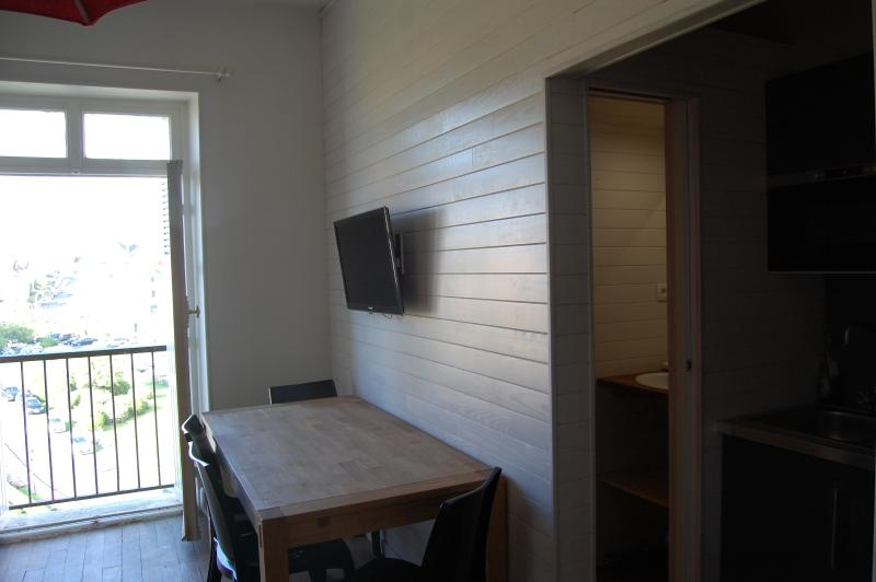 Dinning area and flat screen TV on the wall
