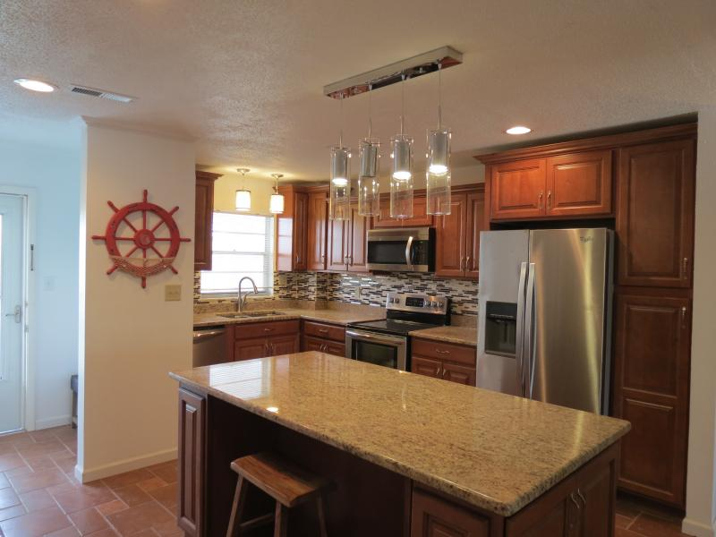 newly remodeled tileflooring thru-out kitchen cabinets, appliances, bathrooms, cabinets
