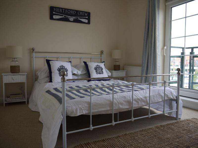 Bedroom with balcony and views of the marina