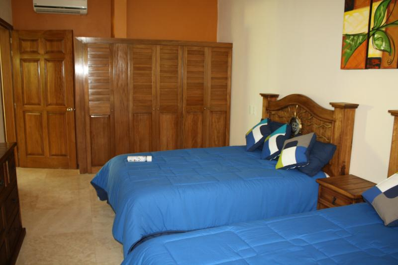 2nd bedroom with two full size beds and wall closet.