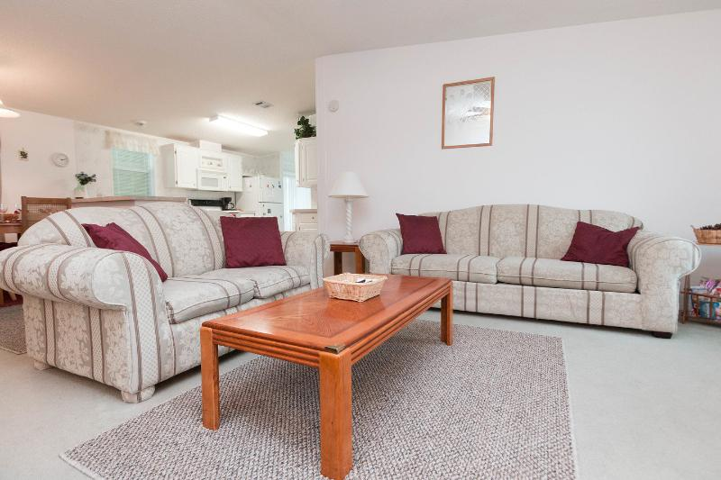 Living Room - bright and spacious with a TV, DVD player and a music centre