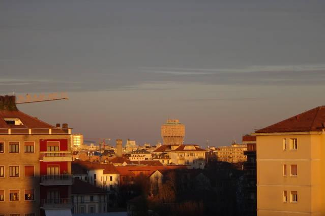 With sweeping views of downtown Milan, the famous torre Velasca!