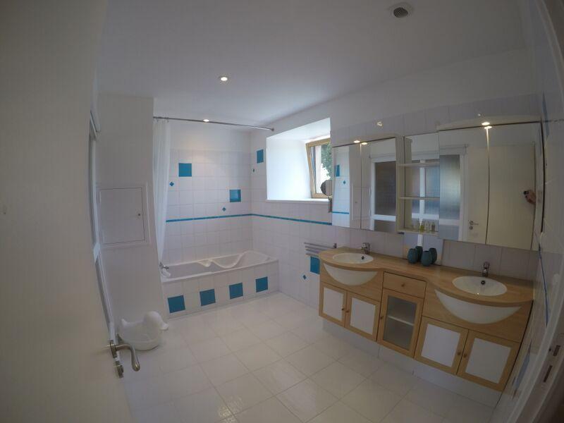 Family bathroom with bath & overhead shower, double sinks