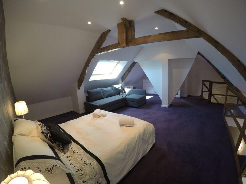 Attic bedroom with beautiful original feature beams
