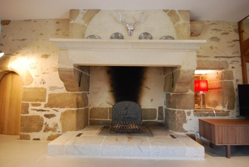 Open feature stone 16th century fireplace in the lounge