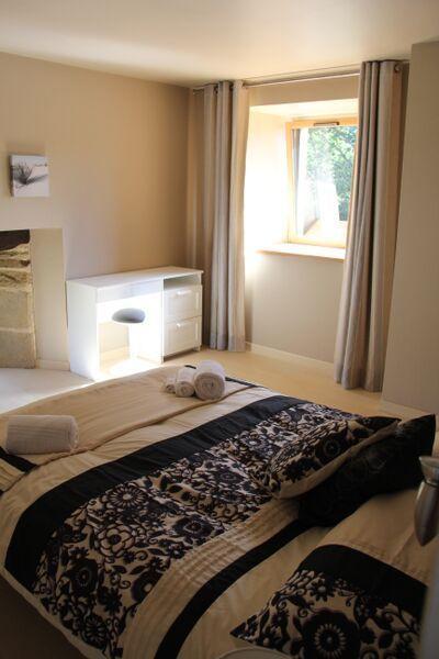 Master bedroom feature stone window