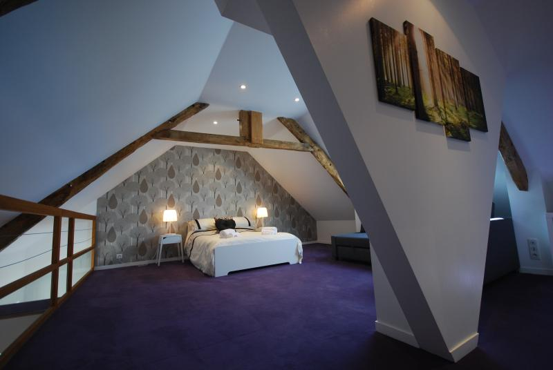 Attic bedroom with dressing area & sofa bed