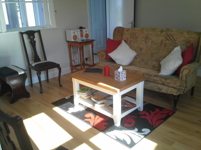 Sitting area of Farm Cottage, books, games, radio as you relax in front of an open turf fire