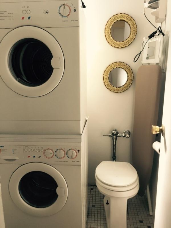 A second toilet and a stacked washer/dryer.