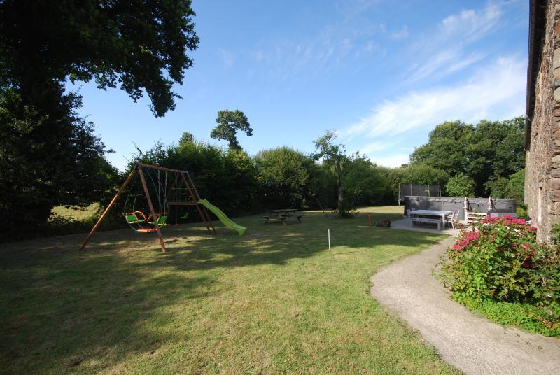 Rear garden with playarea, hammock, swim-spa, bbq & alfresco dining