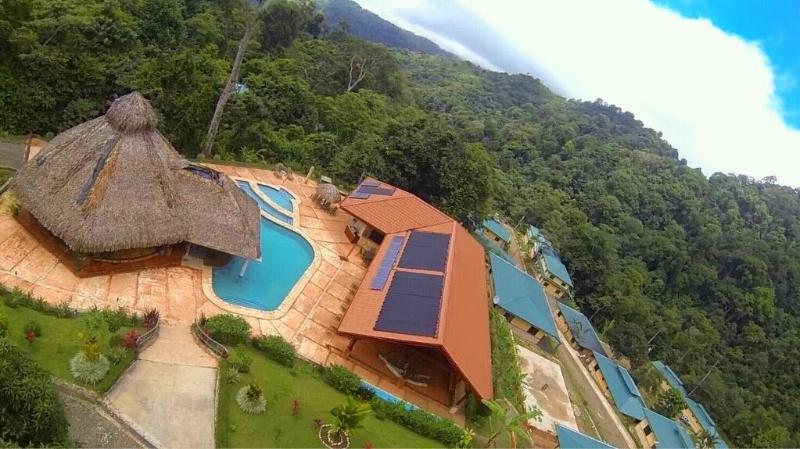 View of the OMV Community Center with Pool, Rainforest Restaurant & Bar