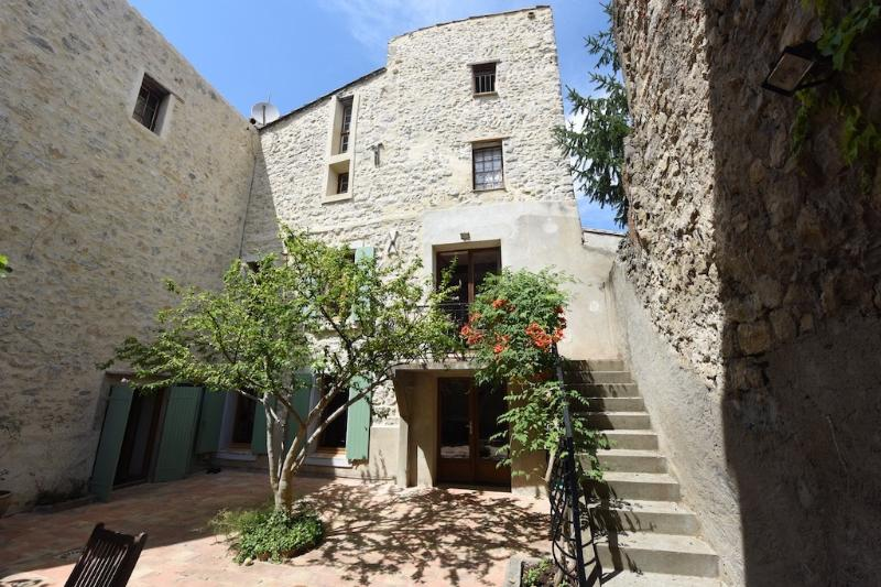 The house is built around the secluded courtyard - ideal for dining  with friends & family.