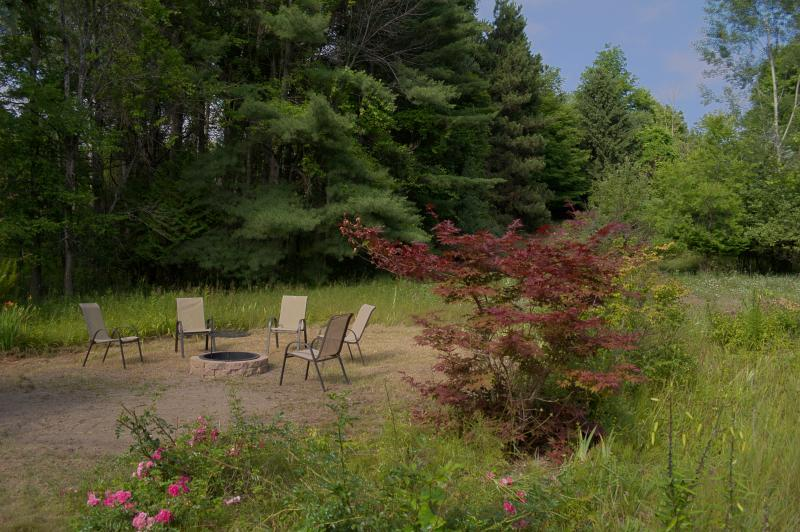 View of the fire pit space looking east on the property