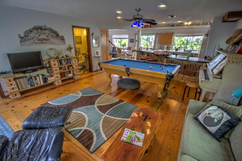 Open, spacious living area with pool table