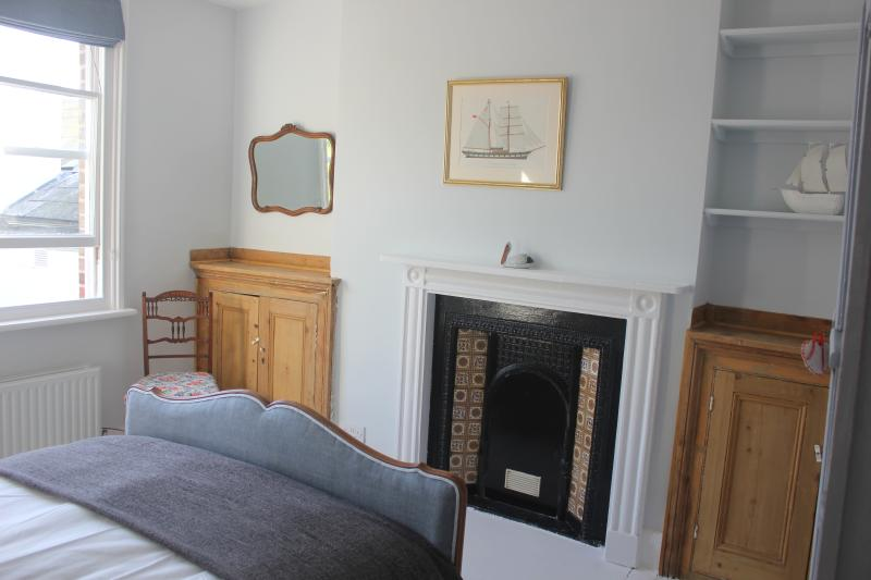 Master double bedroom with original fireplace