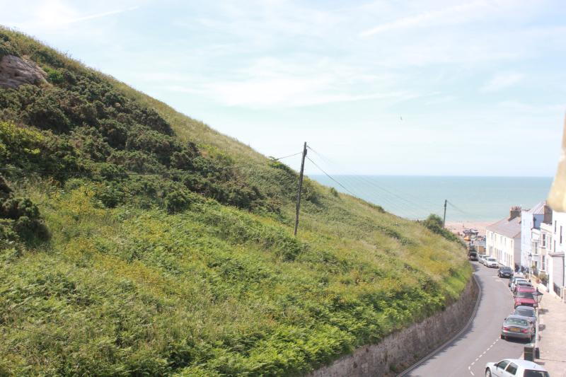 View down Tackleway to sea with East Hill on left from bunk bedroom window