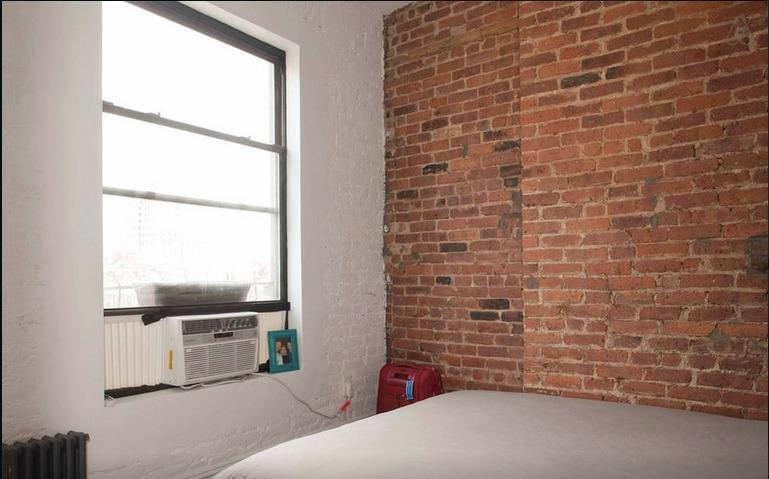 Guest room with closet space, exposed brick, AC, Tempurpedic mattress and city views