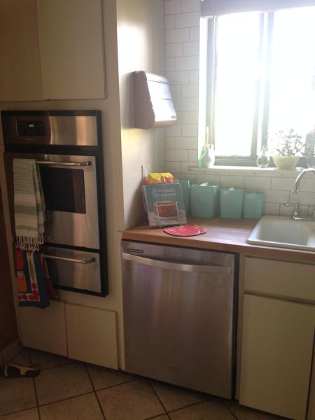 Kitchen features gas stove top and wall oven, dishwasher, microwave, toaster oven, and refrigerator.