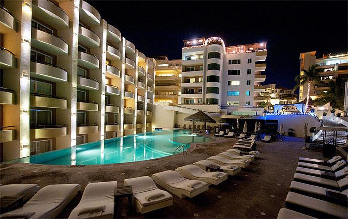 View of Hotel from pool side at night