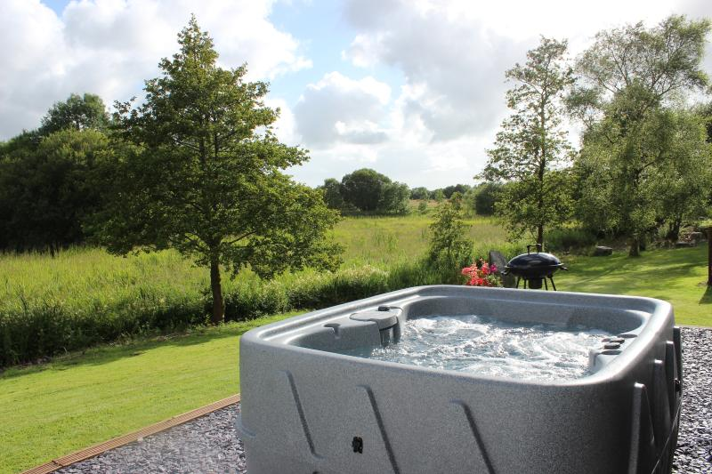 Relax in your own hot tub overlooking the wildlife rich wetland