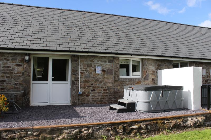 Private patio area with hot tub, alfresco dining and beautiful views overlooking the wetland