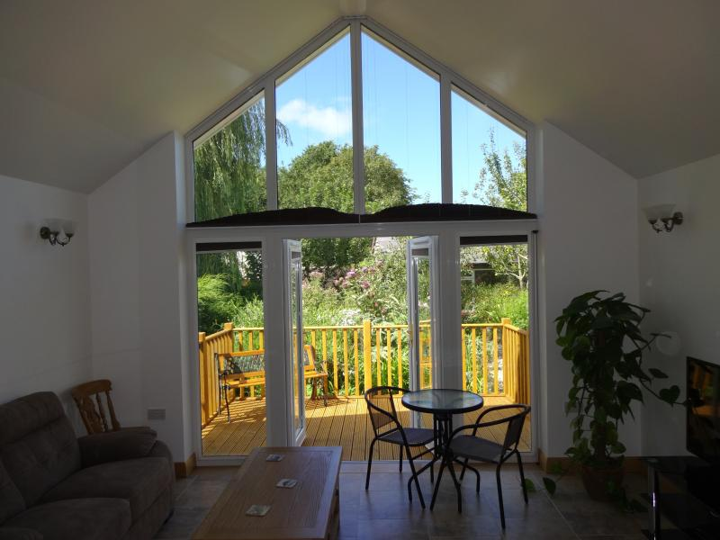 The big window gives a stunning view over the  well stocked garden. Perfect place to 'unwind'