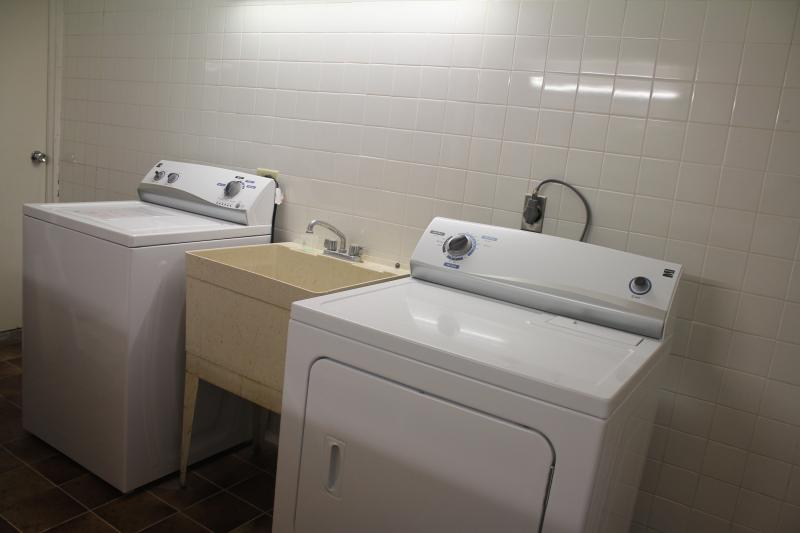 Laundry area with folding table and ironing facilities. All new !