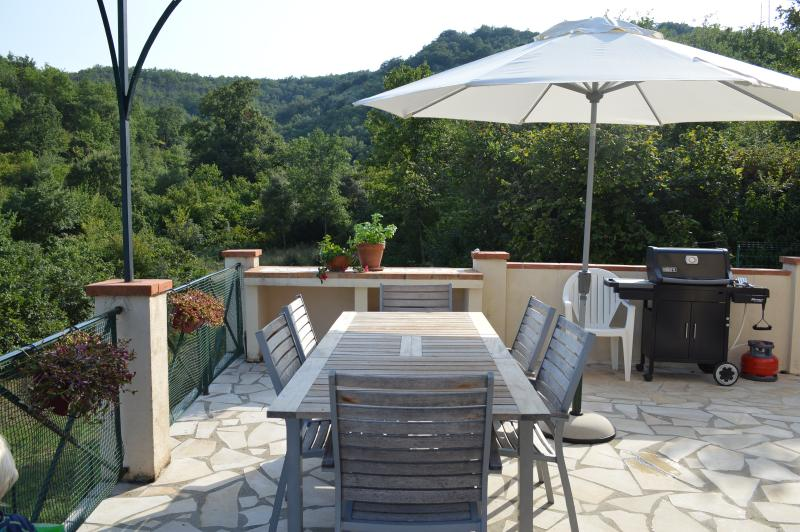 Terrace with dining table and BBQ