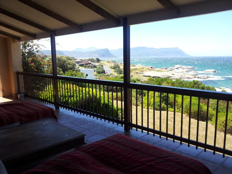 Relax on one of the two sumptuous day beds on the patio overlooking the ocean