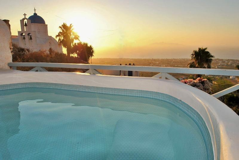 Sunrise from pool with sea view