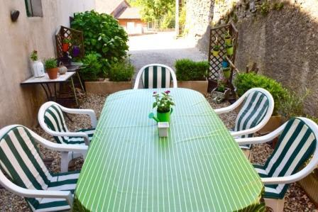 Dine, read or chat at the side terrace table