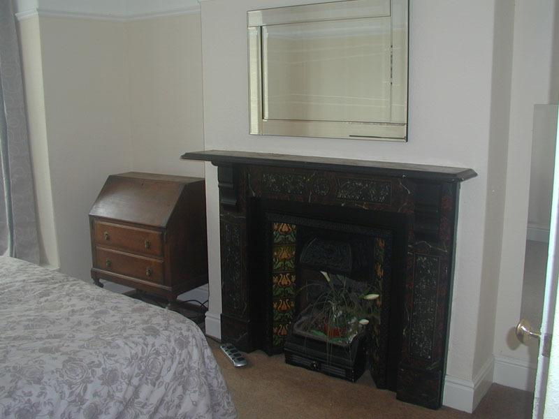 Feature Marble Fireplace Main Bedroom