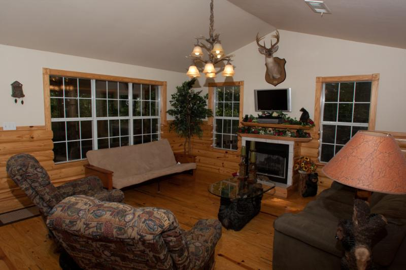 Living room which has a gas fireplace, and Direct TV