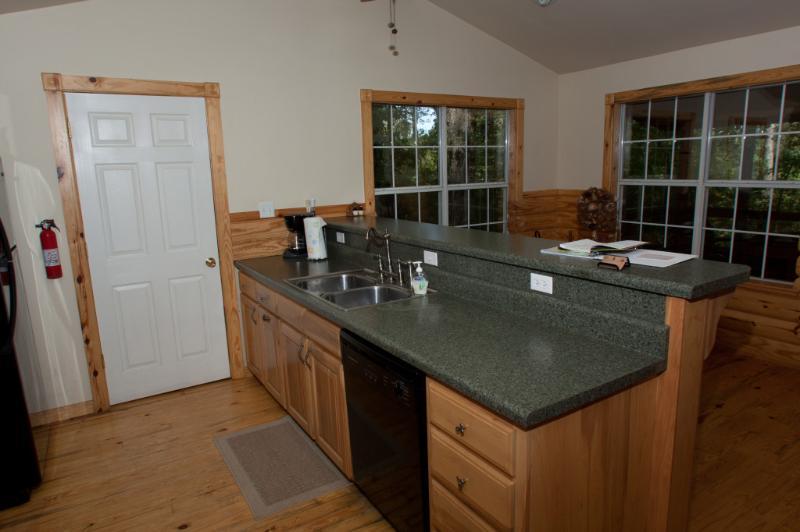 Kitchen area. Has full size refridgerator, stove, and dishwasher