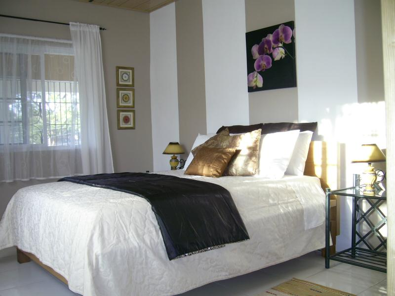 Bedroom: Queen size bed, Large closet, chester draws,  bedside tables, wall mirror ,a/c and fan