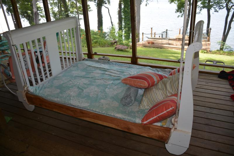 View of lake from hanging bed on screened porch