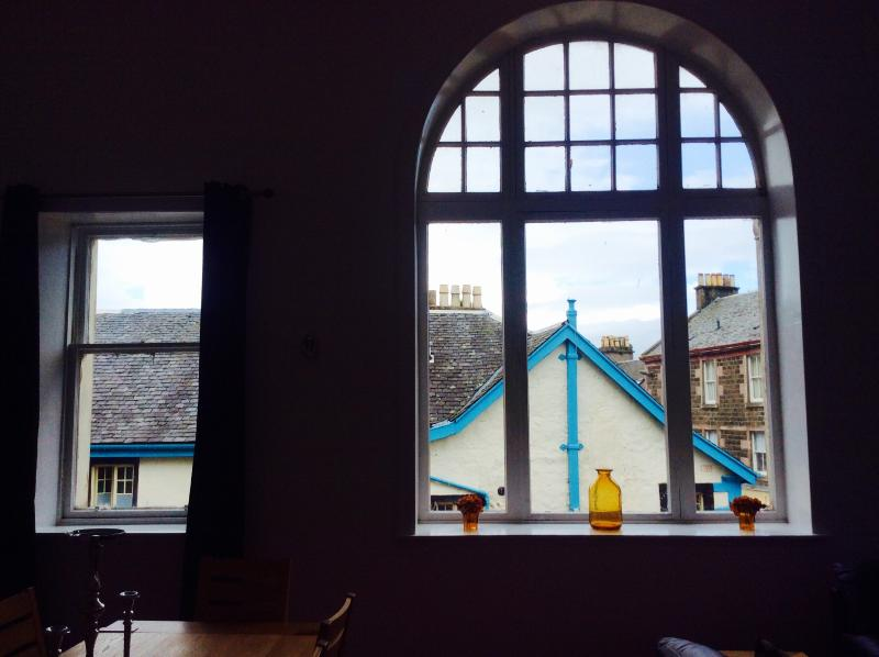 15 foot arched window and 4 sash windows  provide 180 degree views of Rothesay living and light.