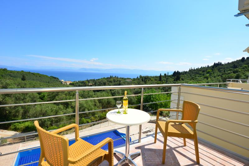 Enjoy breath- taking views from your private balcony of the pool and the surrounding countryside.
