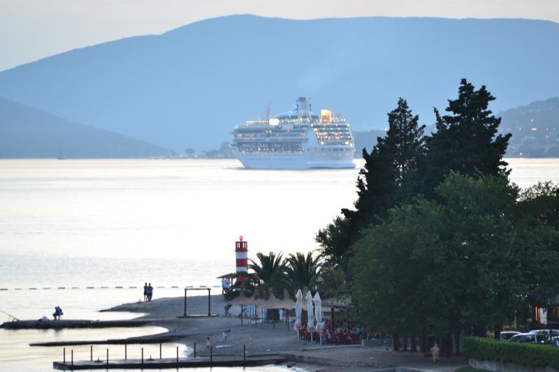 Beach Ponta Seljanovo cruise ship leaving the bay. Bayview Apartments Tivat Montenegro