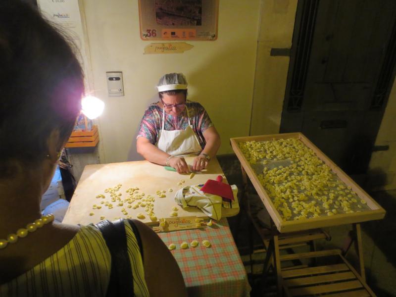Local lady making orecchiette