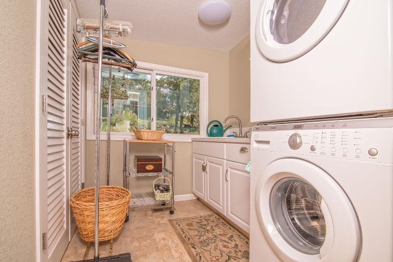 Large capacity Washer and Dryer.  Laundry soap supplied.