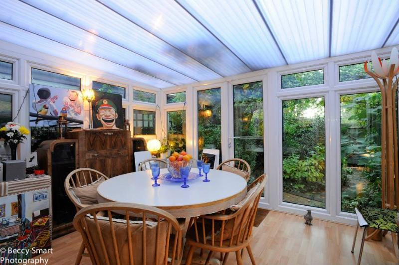 Conservatory overlooking garden where breakfast is served
