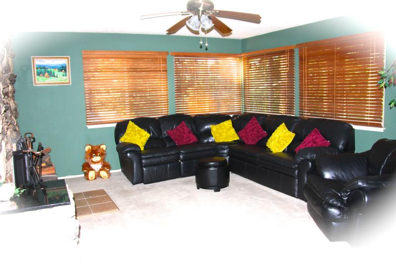 Living room with leather sectional that hides a recliner chair and full size sofa