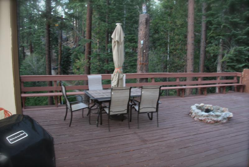 Very private and enormously specious deck with a fire pit